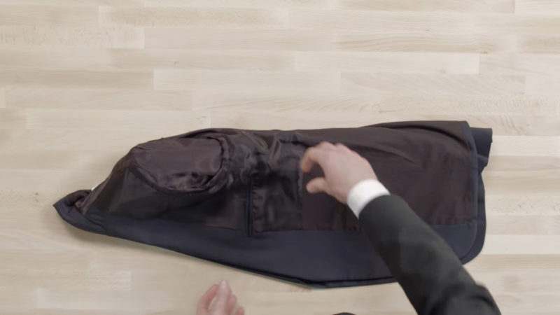 how to fold a suit in a carry on